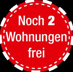 "Stoerer rot Text: ""Noch 2 Wohnungen frei"""